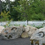 Two of the three Stone Wall Dragons by Carole Hanson - in the Children's Garden